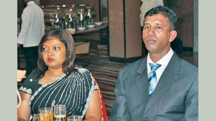 Observer Schoolboy Cricketer of the Year turned ICC Elite Panel umpire Kumara Dharmasena with his beloved wife Dushyanthi.
