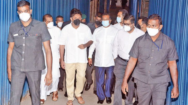 SJB and Opposition Leader Sajith Premadasa and several other party MPs accompanied SJB MP  Nalin Bandara to the CID yesterday. MP Bandara was summoned before the CID to record a statement on the recent comments made by him regarding the 2019 Easter Sunday Terror Attacks and mentioning the name of SIS Director Maj. Gen. Suresh Sallay insinuating he had links with the suicide bomber in Malaysia while he was deployed at the Sri Lankan Embassy there. Picture by Wimal Karunatilake