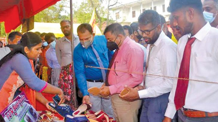 Ampara Additional District Secretary V. Jegatheesan and others inspecting the exhibits. Picture by I.L.M. Rizan, Addalaichenai Central Corr.