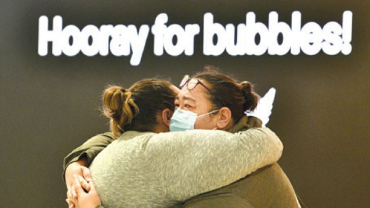 Tearful reunions filled Auckland airport on Monday as residents from Australia were able to travel freely to New Zealand for the first time in more than a year.