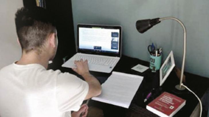 A student of the Faculty of Law of the Aristotle University of Thessaloniki, Greece attends a videoconference course.