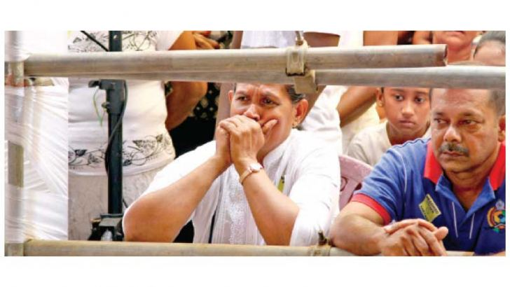 Grieving for relatives at a church service after the blasts.