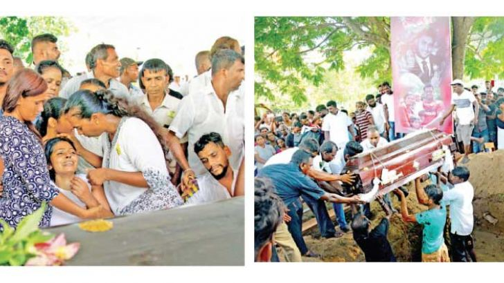 Consoling a grieving relative at a funeral in Katuwapitiya -A poster shows the pictures of the victims of the bomb blasts as they are laid to rest
