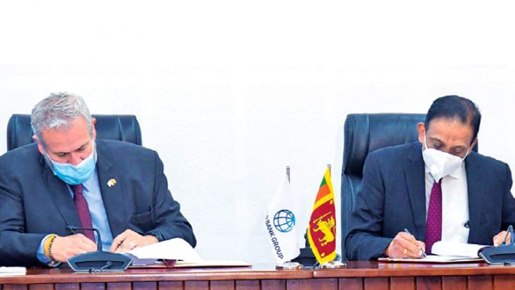 Finance Ministry Secretary S.R.Attygalle and World Bank Country Director  for Maldives, Nepal and Sri Lanka Faris H. Hadad-Zervos signed the  agreement on behalf of the Government and the World Bank