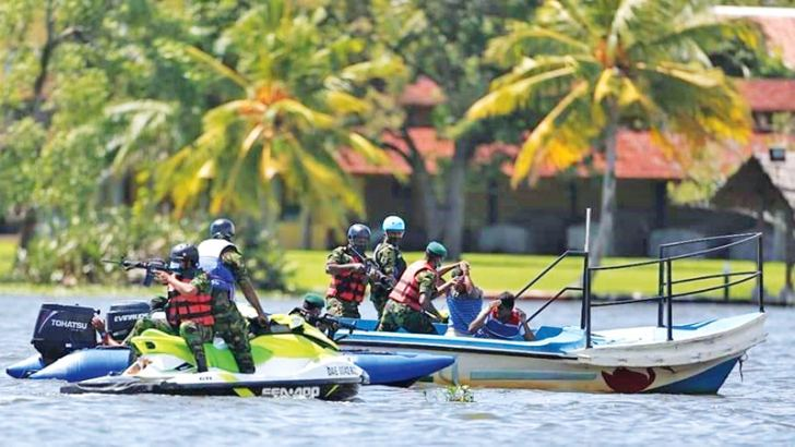Members of the Special Task Force Special Waterborne Operations Squadron displaying their skills during the Unit's inauguration at the Bolgoda Lake.