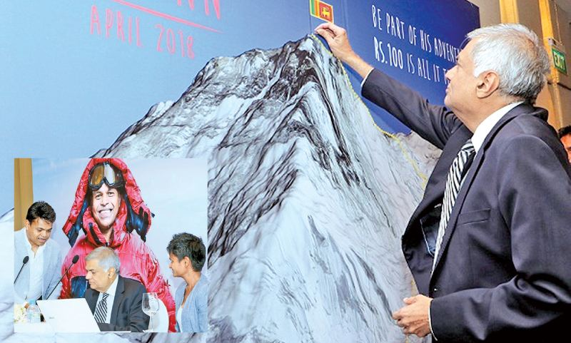 Prime Minister Ranil Wickremesinghe pinning on the trail leads to the summit of Mount Everest, being the first sponsor for one of the steps of the expedition that Johann Peries will make, to be the second Sri Lankan to scale the summit. Jayanthi Kuru Uthumpala, the first Sri Lankan to scale Mt Everest summit and Johann Peries are also in the picture. Pictures by Saman Sri Wedage.