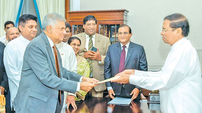 Ranil Wickremesinghe was sworn in as the Prime Minister of Sri Lanka for the fifth time, before President Maithripala Sirisena at the Presidential Secretariat in Colombo yesterday. Picture by Sudath Silva
