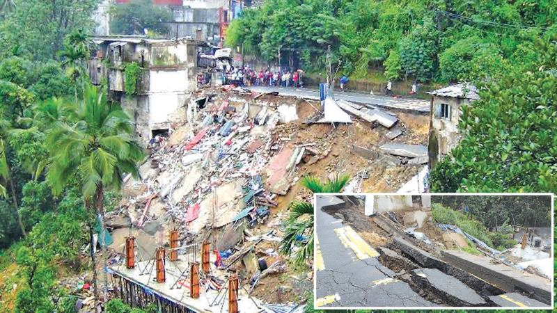 Ten shops in the heart of Ginigaththena town were buried due to a major earthslip  forcing the Police to close a section of  Hatton – Avissawella road in Ginigaththena yesterday morning. A  body of a shop owner who went missing was recovered from the debris yesterday evening.  Picture by  M. Krishanthan -  Hatton Corr.
