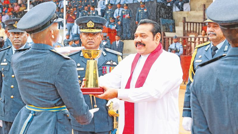 PM AT SLAF ACADEMY AWARDS CEREMONY: Forty Five Officer Cadets and 10 Lady Officer Cadets passed out from the SLAF Academy in China Bay yesterday morning.Prime Minister Mahinda Rajapaksa who was the Chief Guest presents an award to an Officer Cadet who performed exceptionally. Air Force Commander Air Marshal Sumangala Dias was also present. Picture courtesy Prime Minister's Media Division