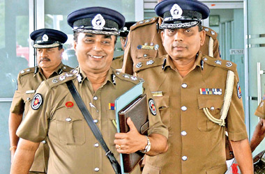 Acting IGP cum Western Province Senior  DIG  Pujith Jayasundara and Colombo District DIG Gamini Mathurata arriving at the National  Police Commission yesterday