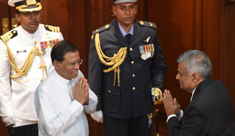 Prime Minister Ranil Wickremesinghe being greeted by President Maithripala Sirisena during the former's swearing-in ceremony.