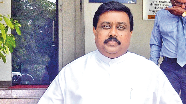 Former North Central Province Chief Minister S.M. Ranjith Samarakoon leaving the Presidential Commission Investigating Fraud, Corruption Abuse of Power State Resources and Privileges yesterday.