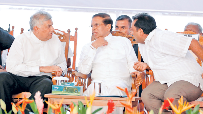 The ground breaking ceremony of the vehicle assembly plant of German automobile manufacturer Volkswagen Company was held in Kuliyapitiya yesterday under the patronage of President Maithripala Sirisena and Prime Minister Ranil Wickremesinghe. Picture shows President Sirisena in conversation with Prime Minister Wickremesinghe and Education Minister Akila Viraj Kariyawasam. Picture by Niroshan Batepola