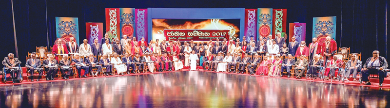 President Maithripala Sirisena posing for a group photograph with the recipients of honorary awards.  Pictures by Sudath Silva
