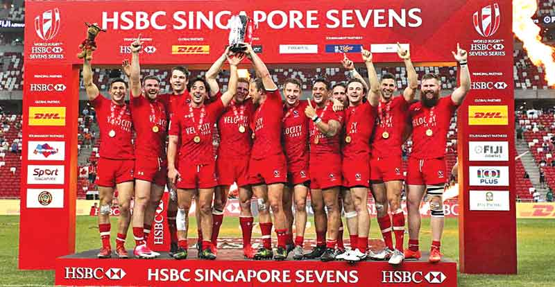 The victorious Canadian team with the Sevens trophy