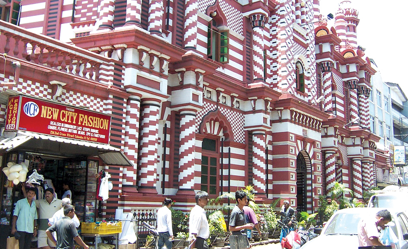 The Red Mosque in Pettah where religion stands side by side with business.