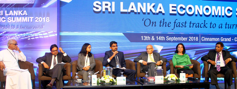Panel discussion - From left; Eran Wickramaratne - State Minister of Finance and Mass Media ,Dr Nishan De Mel - Executive Director, Verité Research (Pvt) Ltd, Anubhuti Sahay - Head, South Asia, Economics Research, Standard Chartered Bank Mumbai ,Shiran Fernando - Chief Economist, The Ceylon Chamber of Commerce, Arun M Kumar - Chairman and CEO, KPMG India Dr Eteri Kvintradze - Resident Representative in Colombo, International Monetary Fund and Asoka Peiris - Chief Executive Officer, Singer Sri Lanka PLC at t