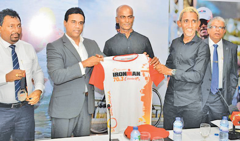 The official jersey of So-Sri Lanka IRONMAN 70.3 unveiled for the media at a press briefing held at Sri Lanka Institute of Tourism and Hotel Management recently. (From left) Prasad Daluwatte - Director of Sri Lanka Tourism Promotion Bureau, Kishu Gomes – Chairman of Sri Lanka Tourism Promotion Bureau, Rajan Thananayagam - Event Director and Director of ProAm Serendib, Yasas Hewage – Director of ProAm Serendib and Captain Athula Hewavitharana – Managing Director of Sri Lanka Ports Authority are in the pictur