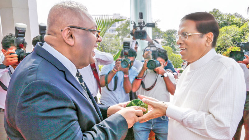 Minister Mangala Samaraweera receives President Maithripala Sirisena on his arrival at BMICH. Pictures by Rukmal Gamage