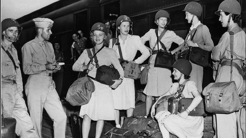 War correspondents and personnel of the Office of Strategic Services, including Virginia Stuart (fourth from left), leaving from Camp Patrick Henry, in Virginia, to go overseas in July 1944.