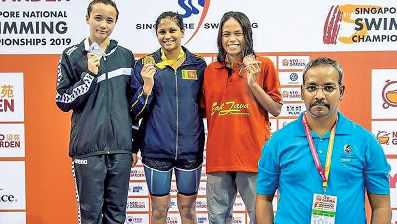 Kimiko Raheem on the podium with her gold medal at the Singapore National Swimming Championships.