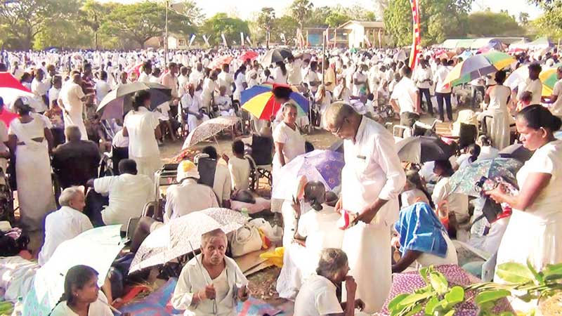 The massive crowd at the so-called religious 'spiritual  healing' camp in Horowpothana, near Anuradhapura.  Picture by Anuradhapura Addl. Corr. Amila Wanasinghe .