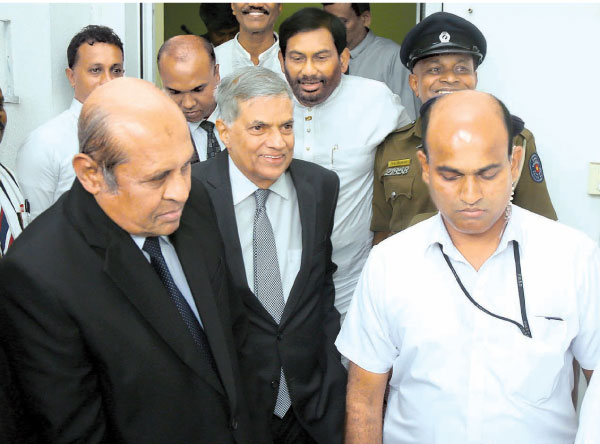 Prime Minister Ranil Wickremesinghe is seen leaving the Commission premises.  Ministers Thilak Marapana PC  and Daya Gamage are also in the picture. Picture by Hirantha Gunathilake