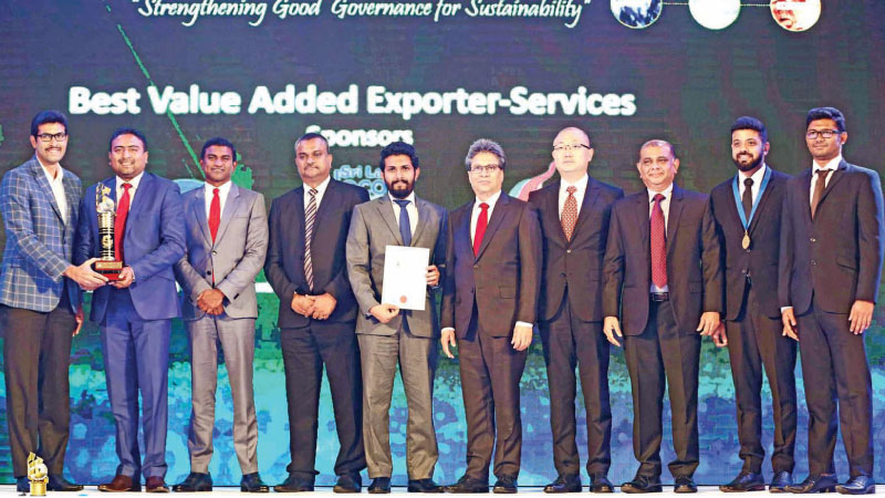 The 99X Technology team with the award for Best Value Added Exporter in the services sector at the awards ceremony