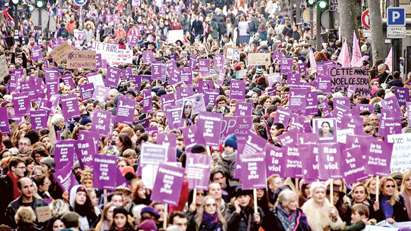 People take part in a protest on Saturday to condemn violence against women in Paris.