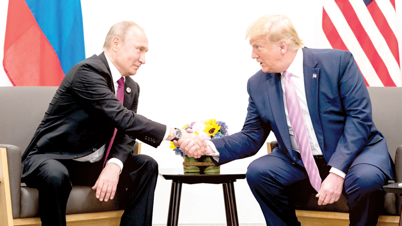 US President Donald Trump shakes hands with Russian President Vladimir Putin during their meeting on the sidelines of the G20 summit.
