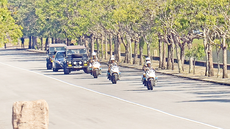 Arrival: The President's official motorcade was escorted by just two security vehicles and three Police motorcycles sans the usual motorcade and the Mounted Police Escort. It is reported that the President had given instructions to cancel the horse and vehicle parade and the 21 Gun Salute which traditionally takes place prior to the commencement of a new Parliamentary session. (Picture by Wimal Karunathilake)