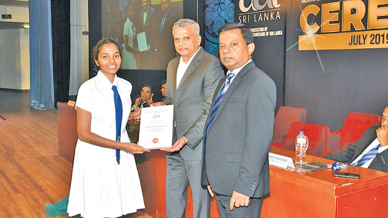 A student receives a certificate