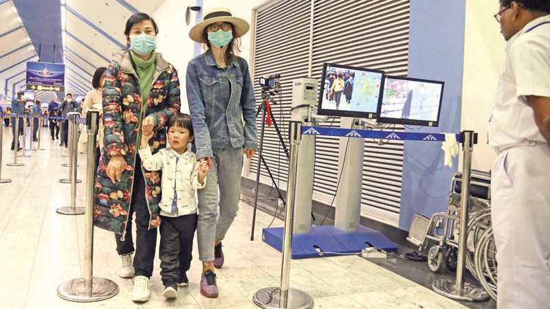 CORONA SCAN: Passengers entering Sri Lanka walk past a thermal scanner at the Bandaranaike International Airport. The thermal scanners help detect if passengers are running a fever in which case they will be monitored further after hospitalisation at the Infectious Diseases Hospital in Angoda. The Health Ministry Quarantine Unit said that a five-member unit is conducting coronavirus scans at the BIA, according to the criteria outlined by the World Health Organization (WHO). Picture by Sulochana Gamage.
