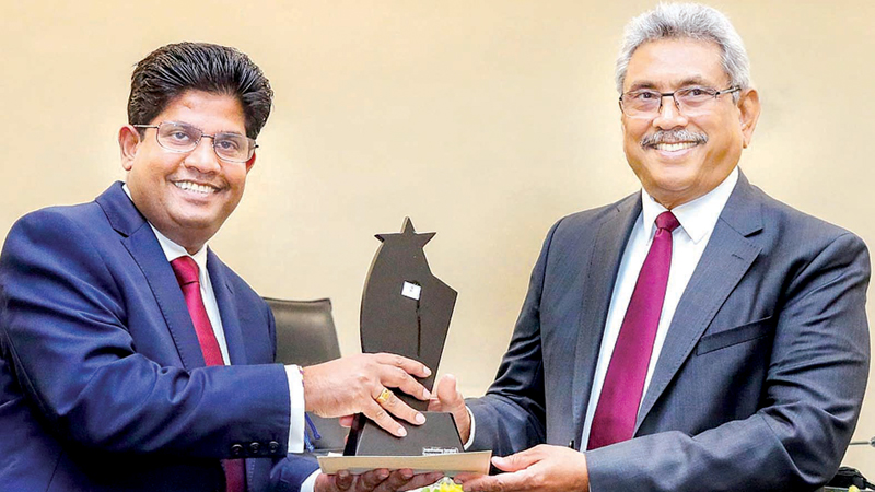 COPA awards: Government institutions which had achieved a high performance in 2018 were presented awards at a ceremony held under the patronage of President Gotabaya Rajapaksa at the Parliamentary Complex yesterday. Picture shows Secretary to the Chief Government Whip of Parliament Chaminda Kularatne receiving an award from the President. Speaker Karu Jayasuriya and Committee on Public Accounts (COPA) Chairman and State Minister Lasantha Alagiyawanna were present. Picture courtesy President's Media Unit