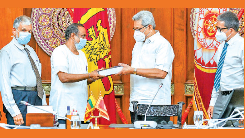 The final report of the four member Committee appointed to review the proposed Millennium Challenge Corporation Compact (MCC) Agreement was handed over to President Gotabaya Rajapaksa at the Presidential Secretariat yesterday. Chairperson of the Committee Prof. Lalithasiri Gunaruwan handing over a copy of the report in the presence of the other members of the committee. (President's Media)
