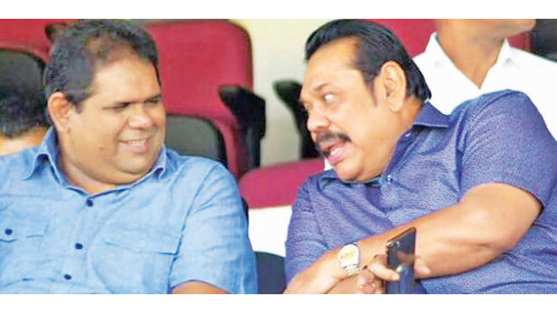 Prime Minister Mahinda Rajapaksa (on right) in conversation with President of Sri Lanka Rugby Lasitha Guneratne