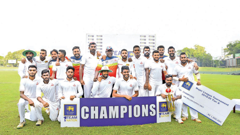 The victorious CCC team poses with the trophy after winning the the SLC Major League Tier 'A' tournament on Thursday.