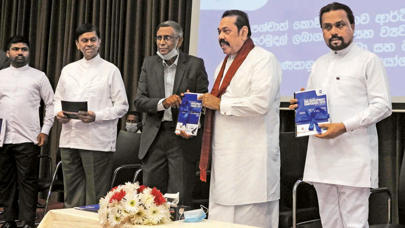 CMA President Prof. Lakshman Watawala presenting an SME development proposal to Prime Minister Mahinda Rajapaksa looked on by other ministers. Picture by Shirajiv Sirimane