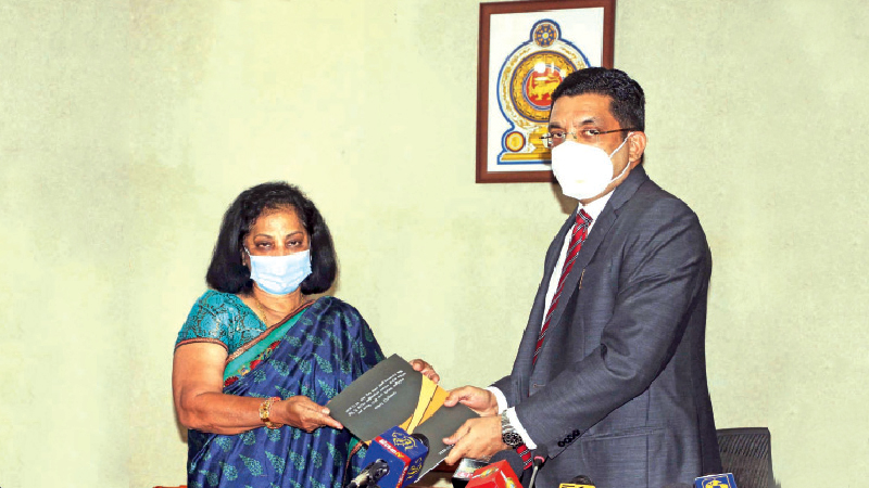 Former High Court Judge and Chairman of the Special Committee probing the Mahara prison incident, Kusala Sarojini Weerawardena is seen handing over the Interim Report of the Committee to Justice Minister Ali Sabry, PC. State Minister of Prison Management and Prison Rehabilitation Lohan Ratwatte,  Committee members and Justice Ministry Chief Legal Advisor U.R.De Silva and Additional Ministry Secretary Rohana Hapugaswatte were present.