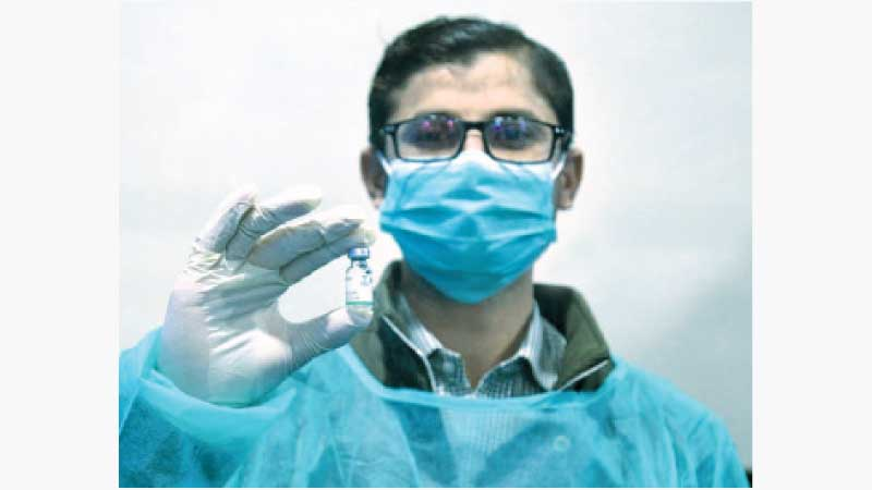 A medical worker shows a dose of China's COVID-19 vaccine in Hyderabad, Pakistan -  Photo courtesy Str/Xinhua)