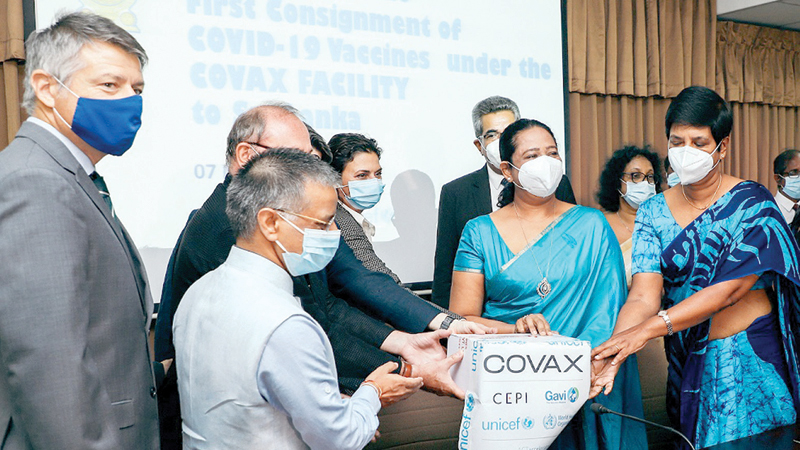 Health Minister Pavithra Wanniarachchi, State Minister Dr.Sudharshani Fernandopulle and senior officials receiving the first batch of doses  from the WHO's COVAX  Facility yesterday.