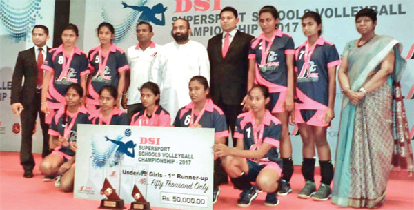 Vijayaba Vidyalaya Hungama were the runners up of Janadhipathi Gold Cup Challenge Trophy Volleyball tournament organized by Dialog in 2019. The winning team posed for a photograph after the finals. Nethmi Kaushalya Nawanjani standing second from left in the back row and President of the Sri Lanka Volleyball Federation Ranjith Siyambalapitiya standing fifth in the back row from left. (Pictures by Dilwin Mendis, Moratuwa Sports Special Correspondent)
