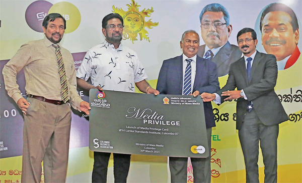 Chairman CBA, Ariyaseela Wickramanayake, presenting a specimen of the Media Loyalty Card to Secretary Minister of Mass Media, Jagath Wijeweera and Minister of Media Keheliya Rambukwella. Picture by Ranjith Asanka