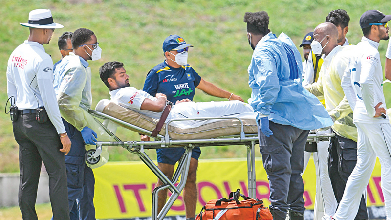 Lasith Embuldeniya is taken off the field by the medical team.