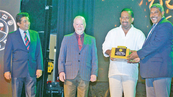 JEDB Chairman, Rtd. Wg. Cmdr. Buwaneka D. Abeysuriya presents a 'Jana Tea' pack to Agriculture Minister Mahindananda Aluthgamage at the JEDB workers appreciation awards ceremony. Picture by Sudath Malaweera