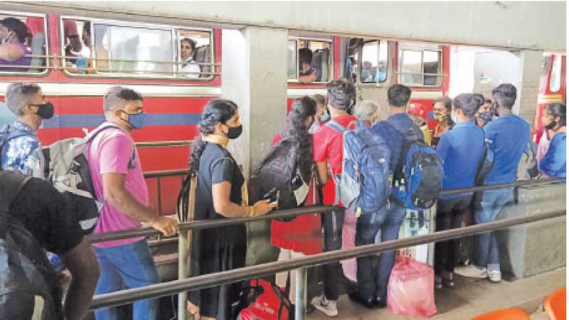 People going to their villages for the New Year queuing at the Central Bus Stand in Pettah yesterday. Picture by Sudath Malaweera