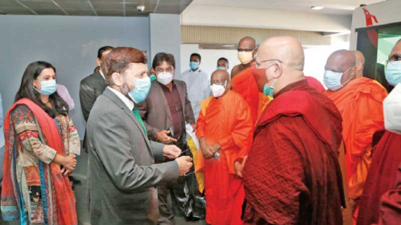 Pakistan High Commissioner Major General Muhammad Saad Khattak along with other officials receiving the delegation led by Buddhist monks at the BIA on their return from Pakistan after concluding the tour.