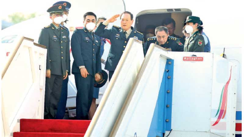 Chinese State Councillor and National Defence Minister Wei Fenghe saluting the island nation a few minutes before leaving the country.