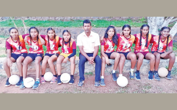 The 2019 Inter School and District runners Up Volleyball Team Wekada Maha Vidyalaya posed for a photograph just after the Finals. Thisathma is seated second from left in the photograph. (Dilwin Mendis, Moratuwa Sports Special Correspondent)