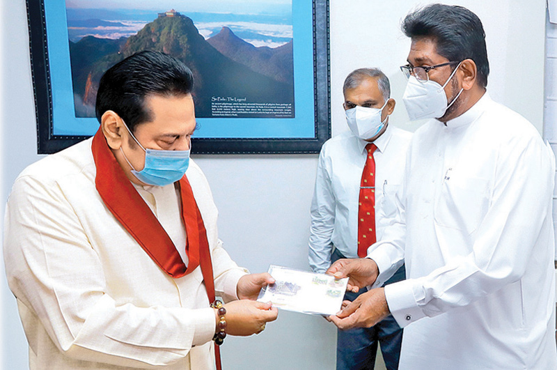 The three Commemorative Stamps, First Day and Commemorative leaflets issued for the National Vesak Festival were presented to Prime Minister Mahinda Rajapaksa at Temple Trees yesterday (12) by Mass Media Minister Keheliya Rambukwella. Picture courtesy Prime Minister's Media Division